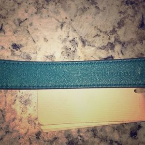 The serial number on the back of the Gucci belt.